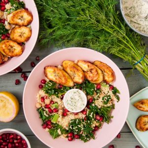 cous cous kale and pomegranate salad with plantains